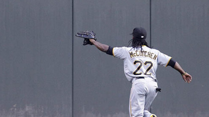 Andrew McCutchen chases a ground rule double hit by the Reds&#039; Scott Rolen into center field in the second inning Monday.