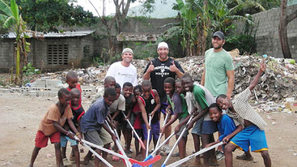Penguins chaplain Brad Henderson, Penguins Max Talbot, Mike Rupp and orphans play with plastic hockey sticks during a trip to Haiti in August.