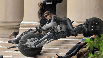Catwoman barrels out of Mellon Institute.