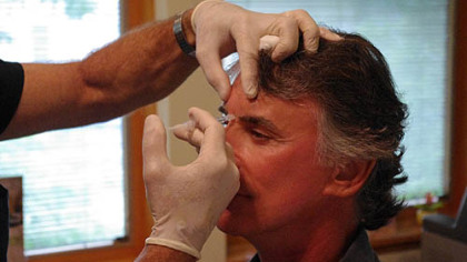 Danny Paranik, 64, of Beaver is injected with Botox by cosmetic surgeon Dominic A. Brandy in Scott Township.