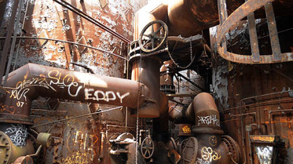 Inside the abandoned Carrie Furnaces, spray-painted &quot;artworks&quot; mix with remnants of the Industrial Age.