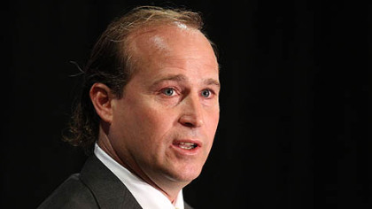 West Virginia coach Dana Holgorsen speaks to the media during the Big East's football media day Tuesday,  in Newport, R.I.