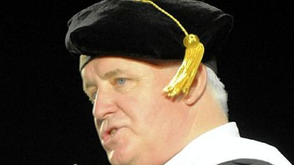 Gov. Tom Corbett speaks at commencement ceremonies for the Duquesne University School of Law at the school's A.J. Palumbo Center on Sunday.