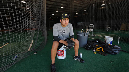 Pirates pitching prospect Luis Heredia watches drills at Pirate City in Bradenton, Fla.