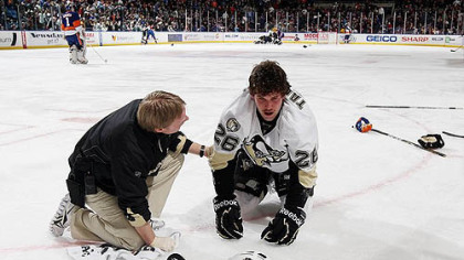 Penguins forward Eric Tangradi is tended to by head trainer Chris Stewart after taking a hit to the head from Islanders forward Trevor Gillies Feb. 11, 2011 at Nassau Coliseum in Uniondale, New York. Tangradi has not played since.