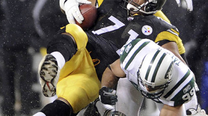 Flozell Adams is tackled by the N.Y. Jets' Jason Taylor after recovering a fumble by quarterback Ben Roethlisberger in December at Heinz Field.