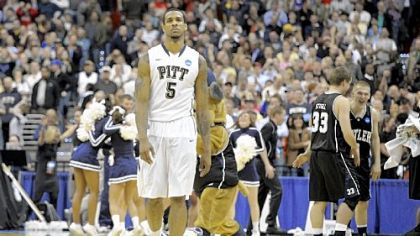 Gilbert Brown walks off the Verizon Center court in Washington after Pitt lost to Butler, 71-70, Saturday night.