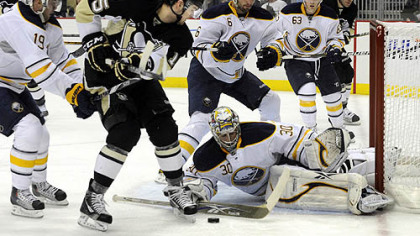 Buffalo's Ryan Miller stops a shot in front of Penguins Dustin Jeffrey.