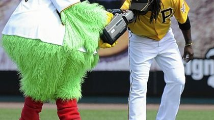 Outfielder Andrew McCutchen gets a camera-eye view from the Pirate Parrot before the start of the Pirates' game against the Toronto Blue Jays at McKechnie Field Sunday in Bradenton, Fla.