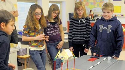 From left, fifth-graders Justin Mondak, Kylee Aquilante, Olivia Dugan, Julianna Rohl and David Hoffman watch as they test their car during a science experiment.