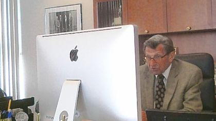 A photo taken from Penn State quarterbacks coach Jay Paterno's Twitter account shows Joe Paterno working at his computer. The veteran coach uses web tools such as Skype to communicate with potential football recruits.