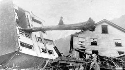 Johnstown Flood image (tree through house): Historic 1889 photo courtesy of Johnstown Area Heritage Association.