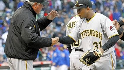 Manager Clint Hurdle and Jose Tabata celebrate the Pirates&#039; 5-4 victory Sunday against the Chicago Cubs at Wrigley Field.