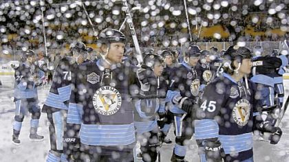 Jordan Staal and the Penguins raise their sticks in tribute to the fans at Heinz Field after Saturday&#039;s Winter Classic.