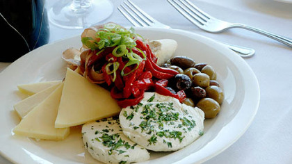 Cheese, pepper and olive appetizer plate.