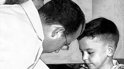 Dr. Jonas Salk prepares to draw blood from Arthur Ddonahoo of Washington, Pa. as part of the polio vaccine testing in the early 1950's.