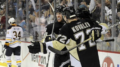 Penguins forwards James Neal and Alex Kovalev congratulate teammate Mark Letestu after scoring in the third period against the Sabres Tuesday at Consol Energy Center.