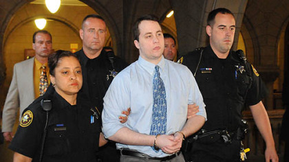Richard Poplawski is escorted from the Allegheny County Courthouse.