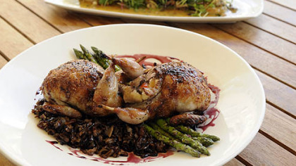 The real thing, done well: Wood roasted quail (foreground) with frog legs