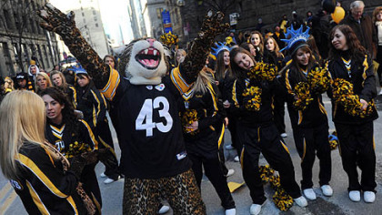 Thomas Jefferson High School's cheerleaders and mascot, a Jaguar dressed in a Troy Polamalu Jersey.