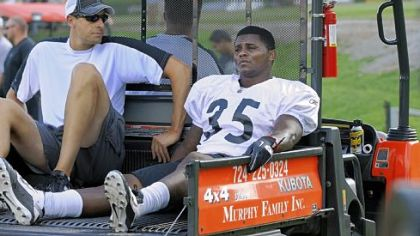 Barron Batch is taken off the field on a cart after an injury to his left knee at the end of practice Wednesday.