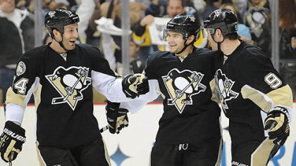 Penguins forward Chris Kunitz, center, celebrates a goal with defenseman Brooks Orpik, left and Pascal Dupuis in the first period of Wednesday&#039;s game against the Lightning at Consol Energy Center.