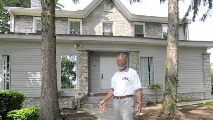 Daniel Elby, CEO of Alternative Rehabilitation Communities, outside the A.R.C. Woodland home in Harrisburg.