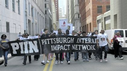 Organized by CeaseFirePA and the Pittsburgh Interfaith Impact Network, a protest march against gun violence, which began at Freedom Corner in the Hill District, moves through Downtown en route to the David L. Lawrence Convention Center, Downtown, on Saturday.