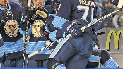 Evgeni Malkin leaps into the bench after scoring in the second period against the Capsitals last night at Heinz Field.