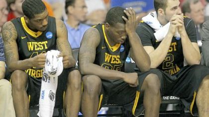 West Virginia's John Flowers, left, Darryl Bryant and Cam Thoroughman watch the final moments of Saturday's loss.