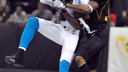 The Philadelphia Soul's Larry Brackins makes a reception in front of the Power's  Royce Adams during tonight's game at Consol Energy Center.