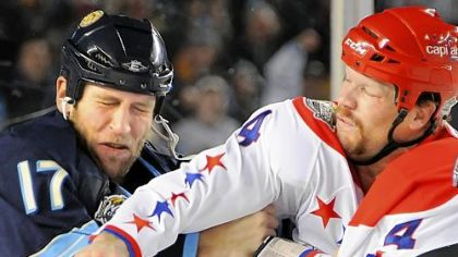 "Penguins' Michael Rupp: ""There's no secret that we don't like each other."" Shown here, the Capitals' John Erskine lands a right cross on Rupp in their clash in the first period at Heinz Field last night."