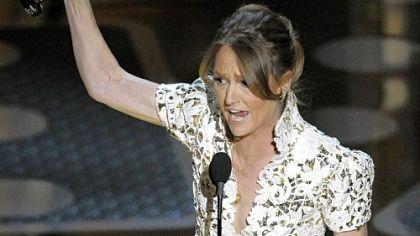 Melissa Leo wields her Oscar on Sunday night.