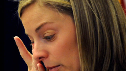 "Brooke Hicks pauses as she talks about her husband, FBI Special Agent Samuel Hicks, this morning in the Federal Courthouse. She said of the negotiated sentence of Christina Korbe: ""The most important thing was she stood up in that courtroom and accepted responsibility for shooting Sam."""