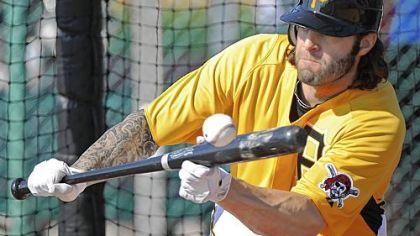 Joe Beimel lays a bunt down in pitcher drills Sunday afternoon at Pirate City in Bradenton, Fla.