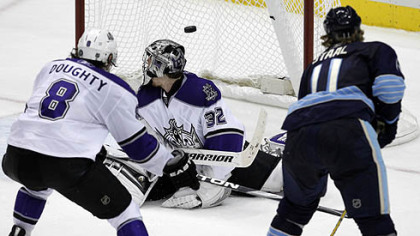 Penguins forward Jordan Staal fires a shot past Kings goaltender Jonathan Quick as Kings defenseman Drew Doughty gives chase in overtime of Thursday&#039;s game at Consol Energy Center.