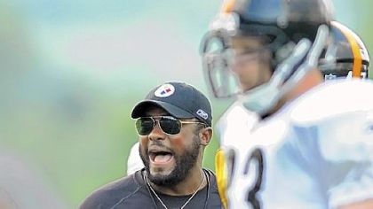 Steelers head coach Mike Tomlin provides some motivation for his players during training camp at Saint Vincent College in Latrobe.
