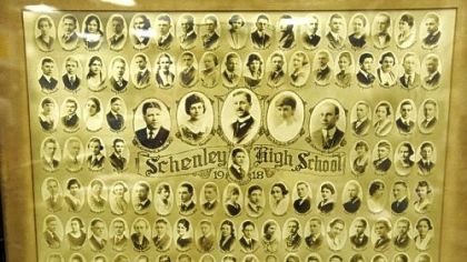 A framed photograph of the first graduating class of Schenley High School in 1918 is part of senior James Hill's collection of memorabilia.