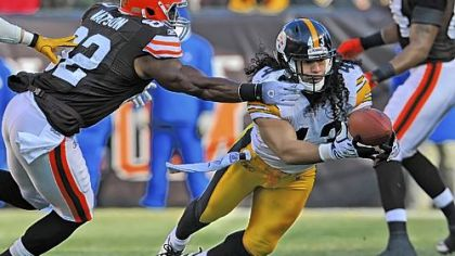 Troy Polamalu intercepts a pass from Browns quarterback Colt McCoy in the first quarter.
