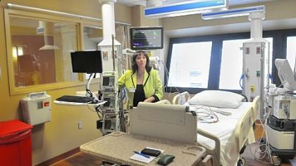 Angela Costa, AGH's director of the nursing division, explains the set-up of a room at Allegheny General Hospital's new neurosurgical ICU.