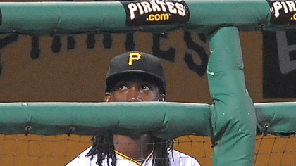 Pirates outfielder Andrew McCutchen sits in the dugout after being benched by manager Clint Hurdle against the Dodgers at PNC Park Thursday.