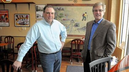 Progress Fund CEO David Kahley (right) with Rod Darby, owner of The Trailside, a restaurant and bar along the Great Allegheny Passage Trail in West Newton.