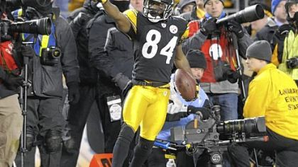 Receiver Antonio Brown celebrates after catching a pass from  Ben Roethlisberger in the fourth quarter to seal the victory against the Jets in the AFC championship Sunday at Heinz Field.