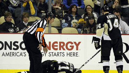 Penguins forward Chris Kunitz skates towards teammate Evgeni Malkin who lies injured on the ice during the second period of Friday's 3-2 win against the Sabres at Consol Energy Center.