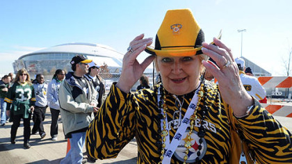 Dolly McQuaid of Bethel Park models her Western-style Steelers garb.