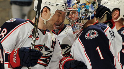 Blue Jackets forward R.J. Umberger congratulates goaltender Steve Mason after a 4-1 win Tuesday at Consol Energy Center.