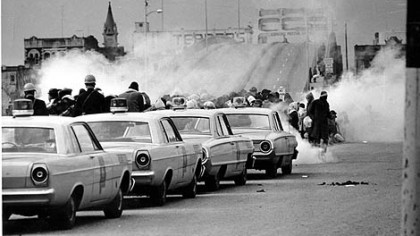 As the march began on March 7, 1965, Alabama state troopers fired tear gas on participants at the Edmund Pettus Bridge in Selma, then assaulted the marchers with clubs and whips.