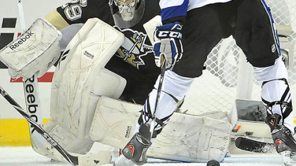 Penguins goaltender Marc-Andre Fleury makes a save on Lightning goaltender Vincent Lecavalier in the third period of Wednesday's game at Consol Energy Center.