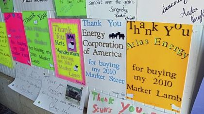 Signs thanking buyers of their livestock are hanging at the Greene County Fair in Waynesburg, Pa. The fair has many energy-related sponsors including EQT Corporation Chevron, Consol Energy and ECA Energy. The 4-H Market sale includes purchases by energy companies.