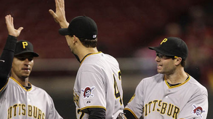 Pirates pitcher Charlie Morton, center, is congratulated by second baseman Neil Walker, right, and shortstop Ronny Cedeno following Friday's game at Great American Ballpark in Cincinnati.